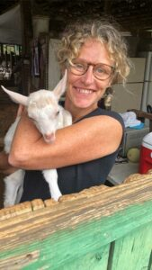 Tania holding a goat