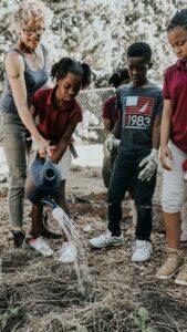 Tania gardens with kids